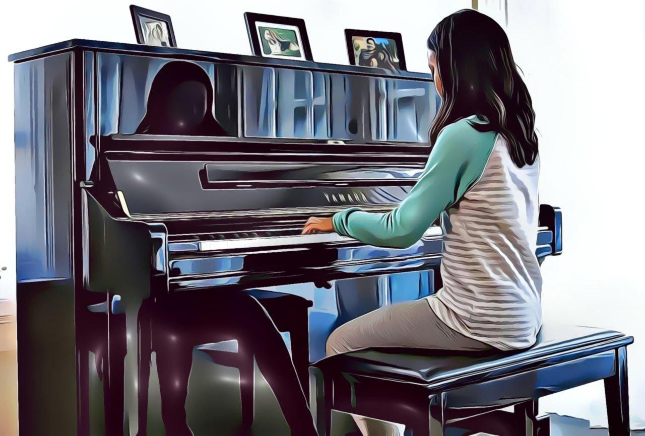Child Playing The Yamaha U1